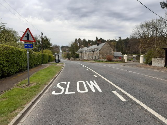 'Slow' signs have been painted on the road at Middleton, near Belford, but parish councillors want to see the speed limit lowered.