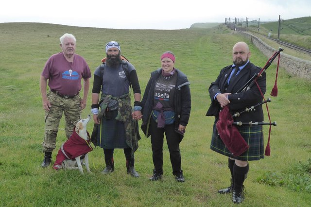 Chris Lewis, Kate and Jet with fellow paratrooper Alan Hughes, left, and piper Jamie Starr, right, on Sunday. Picture by Susan Hughes.