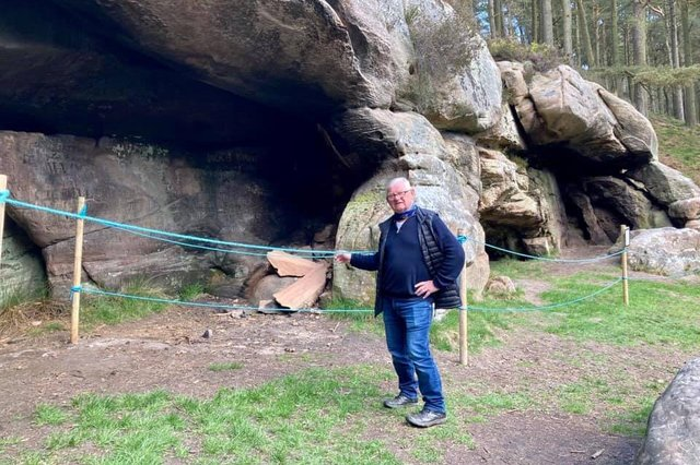 Cllr Colin Hardy at St Cuthbert's Cave, which has been roped off due to vandalism.