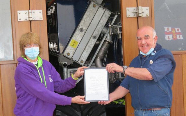 Seahouses lifeboat crew member Julie Harris is presented with her volunteer award certificate by operations manager Ian Clayton.