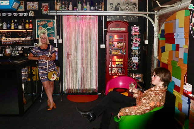 Pam Johnstone enjoys a drink in her Cavern Club inspired home bar.