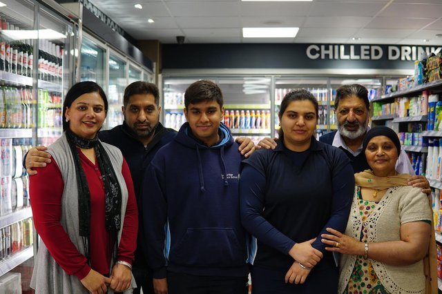 Businessman Kashmir Nijjar and his family at the Tweedmouth Costcutter store which has had a £120,000 refurbishment.