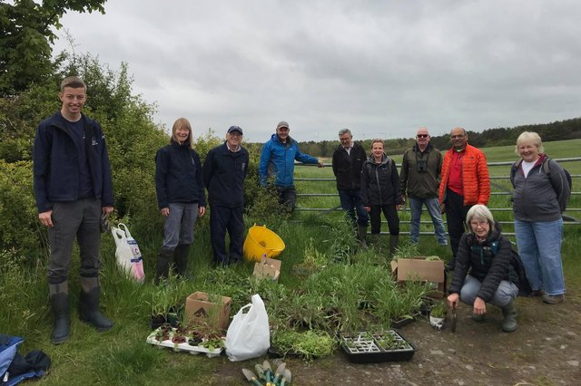 Joel Ireland, far left,with his team of volunteers about to start planting flowers. Picture byChloe Cook.