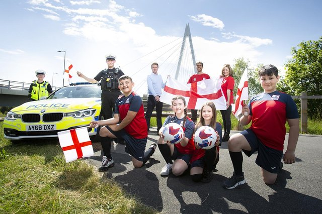 Northumbria Police Sgnt Steve Chappell and PC Greg Huntley, Coun Kevin Johnston, Peter Slater and Cheryl Ford-Lyddon, of RSGB NE, and Northern Saints Primary School pupils Frankie, Lily, Leia and Jayden.
