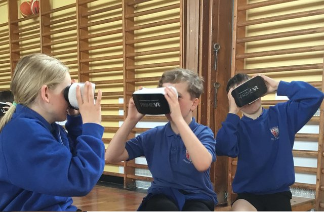 Glendale Middle School pupils try out the virtual reality headsets.