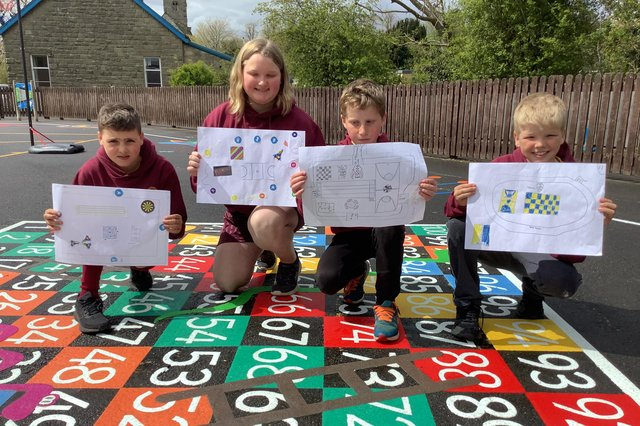Pupils with their designs.