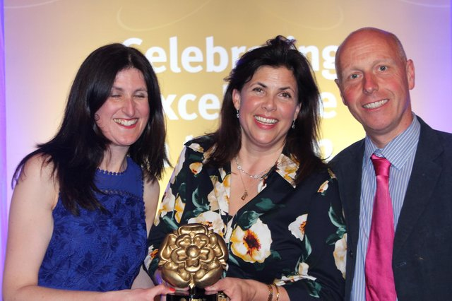 Dave and Harvest Harris-Jones receiving their Visit England award for sustainable tourism from TV presenter Kirstie Allsop.
