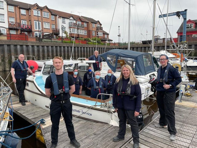 Front left Chris Bullock with Head of Unit Angela Carrington and Deputy Head of Unit Jennifer Mitchelson, and the volunteers