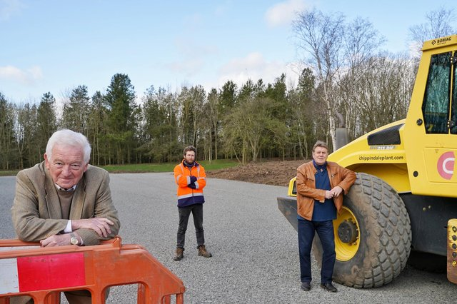 Cllr Jeff Watson (left), Cllr Malcolm Robinson (right) and Danny Goodall from the countryside team at the new car park extension at Plessey Woods Country Park.