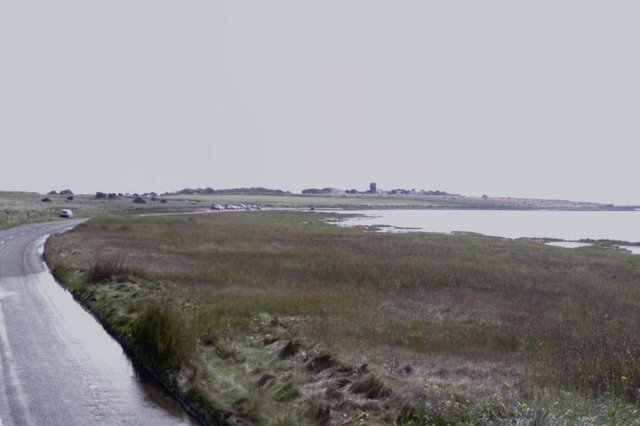 The emergency services were called to the Holy Island Causeway after a vehicle became stuck. Image copyright Google.