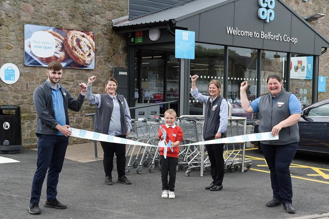 Store manager Tammy Robson, second from right, and staff, Joseph Threlfall, Lisa Court and Louise Melvin, with help from Ewan Middleton, one of the pupils from Belford Primary School, officially open the new-look Co-op. Picture by Chris Watt, www.chriswatt.com