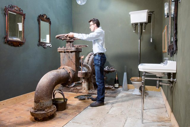 Shaun Renwick of Cragend Farm with the turbine invented and made by Lord Armstrong of Cragside.
