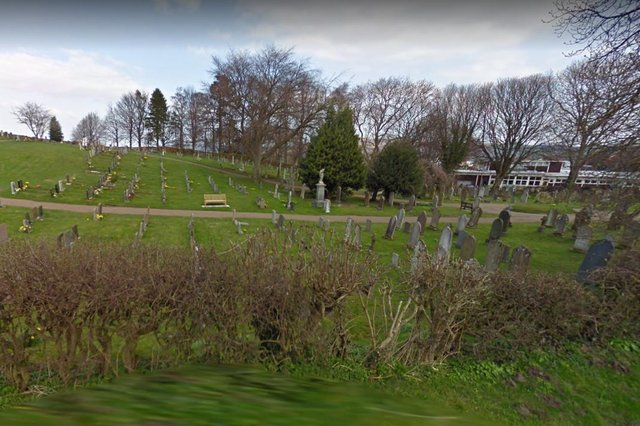 Wooler burial ground with the former first school beyond.