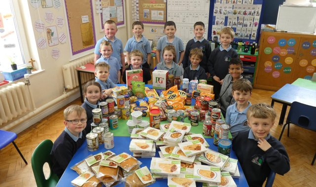 Ellingham C of E Primary School pupils with the donations for Alnwick and District Food Bank.