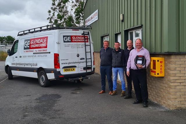 Gordon Wilson, Richard Wilson, Paul McKenna and Graeme Wilson of Glendale Engineering with the defibrillator.