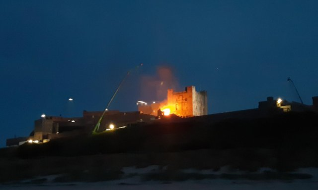 A fire at Bamburgh Castle as filming takes place for a new Indiana Jones movie.