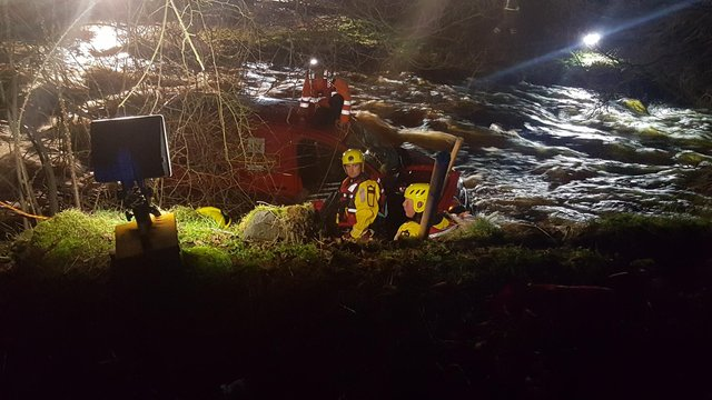 Emergency service workers rescue man on top of Royal Mail van swept away from ford crossing