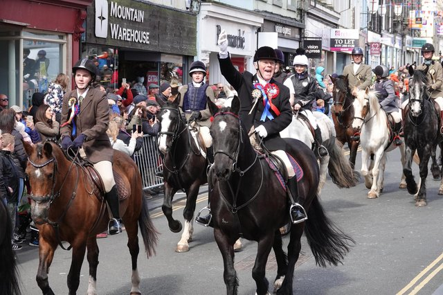The cavalcade makes its way out of Berwick after receiving permission from the mayor to ride the bounds. Picture by Jane Coltman