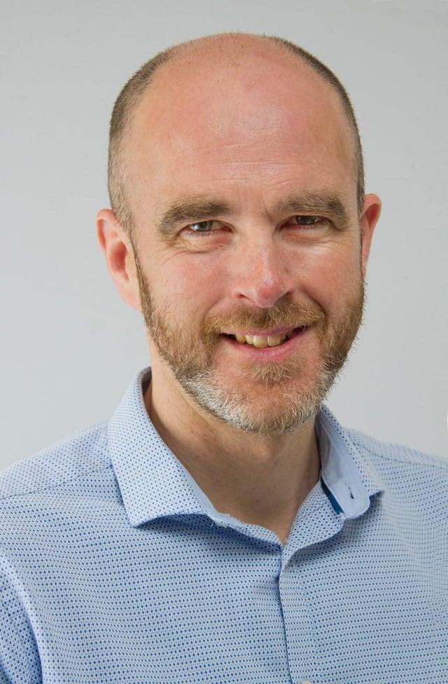 Dr Graham Syers.
