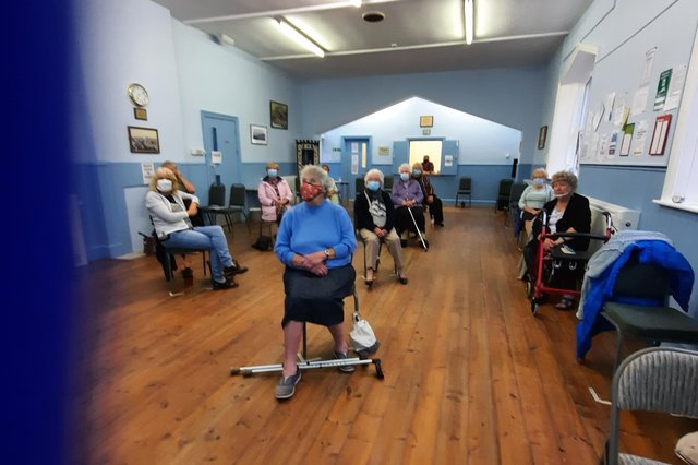 A socially distanced meeting in Craster Memorial Hall.