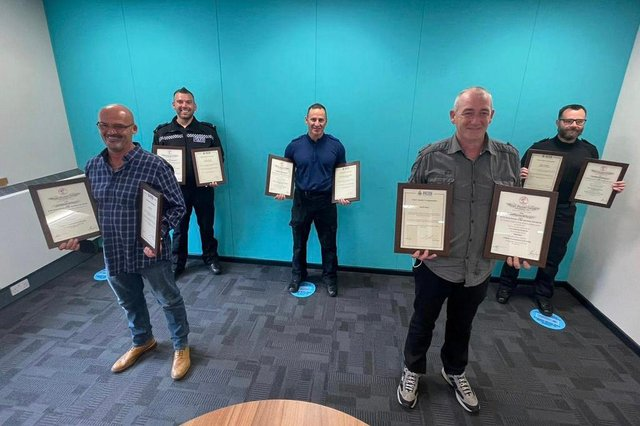 Jimmy Garner (left) and David Hood front with (back from left to right) PC Ed Armstrong, PCSO Neil Humble and PC Ross McKenziethree, who were all awarded Chief Constable Commendations and certificates from the Royal Humane Society in recognition of their life-saving actions.