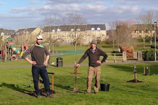 Alnwick town councillors Peter Edge and Martin Swinbank help plant fruit trees in Swansfield Park.