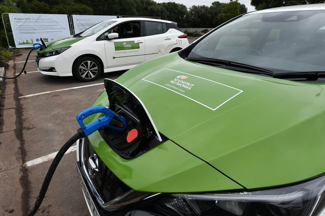 Electric vehicles being charged. Picture by John Devlin.
